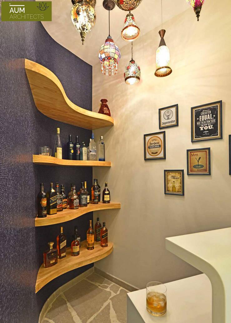 Duplex Apartment design: mediterranean Wine cellar by Aum Architects