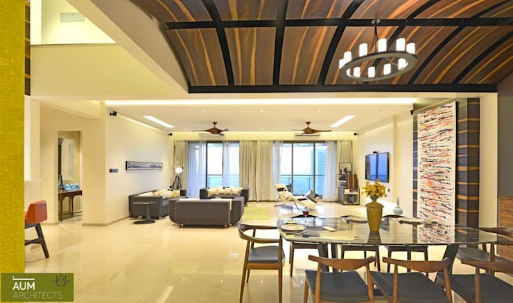 Duplex Apartment design:  Living room by Aum Architects
