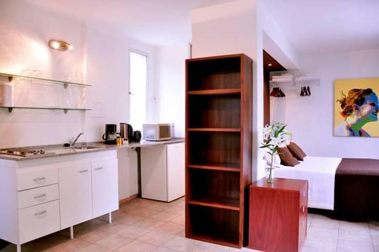 EDIFICIO MODIGLIANI: Dormitorios de estilo  por sm arquitectura