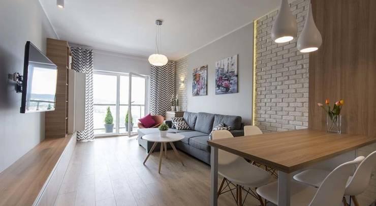 Nowoczesne mieszkanie w jasnych kolorach: styl , w kategorii Salon zaprojektowany przez Inspiration Studio