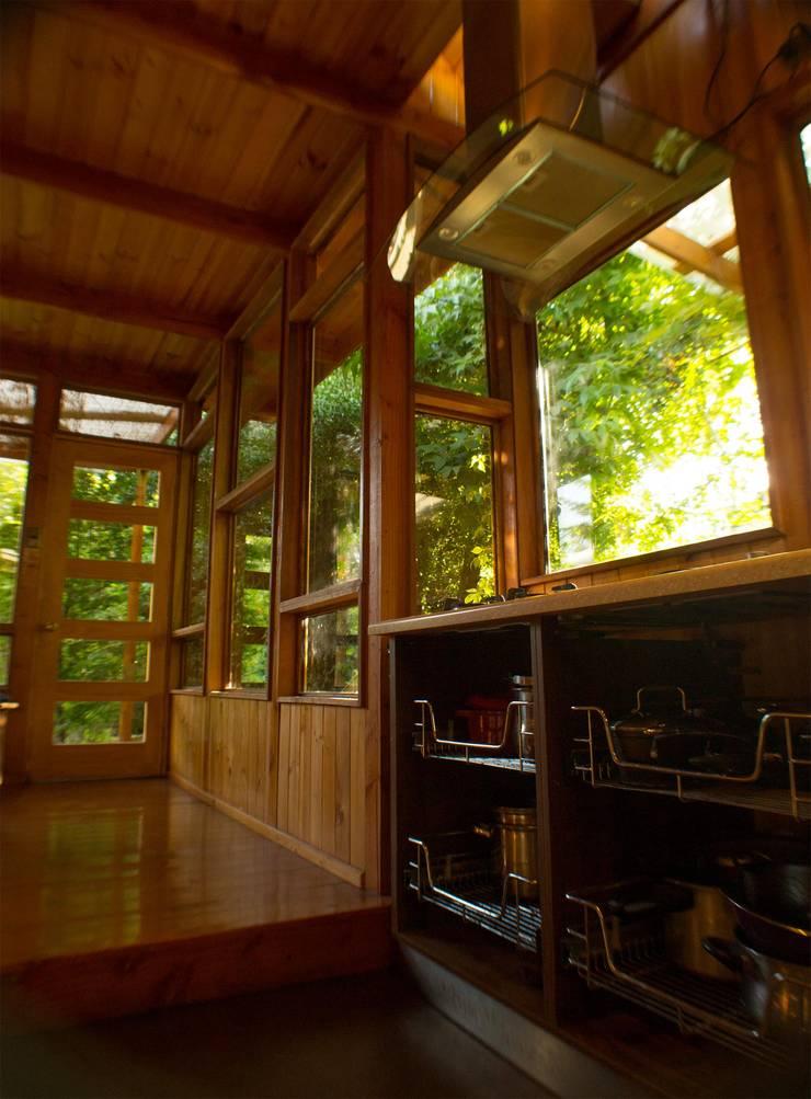 Galeria Cocinas de estilo rústico de PhilippeGameArquitectos Rústico Madera Acabado en madera