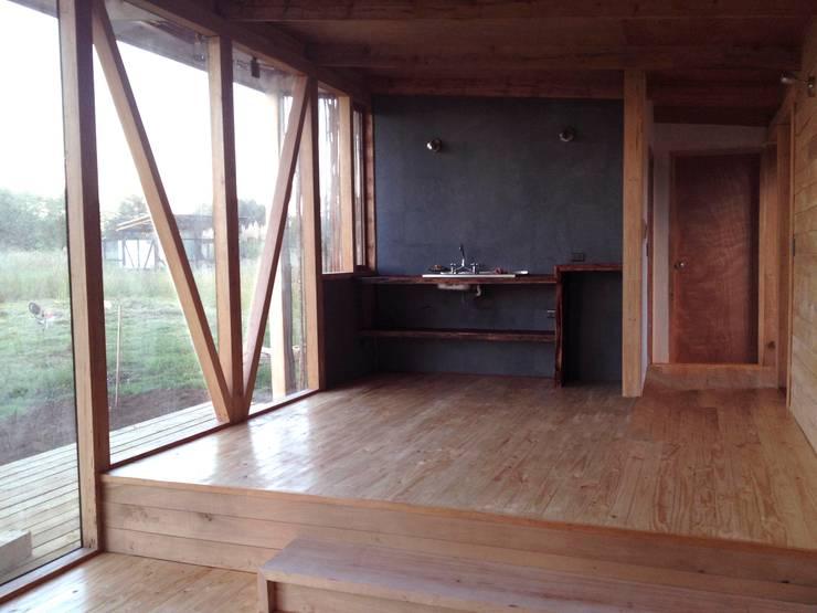 Living: Cocinas de estilo moderno por PhilippeGameArquitectos