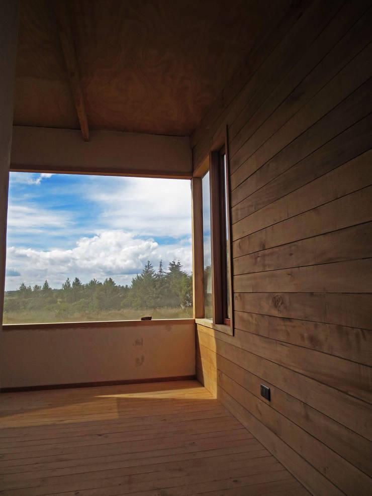 Habitaciones de estilo  por PhilippeGameArquitectos, Moderno Madera Acabado en madera
