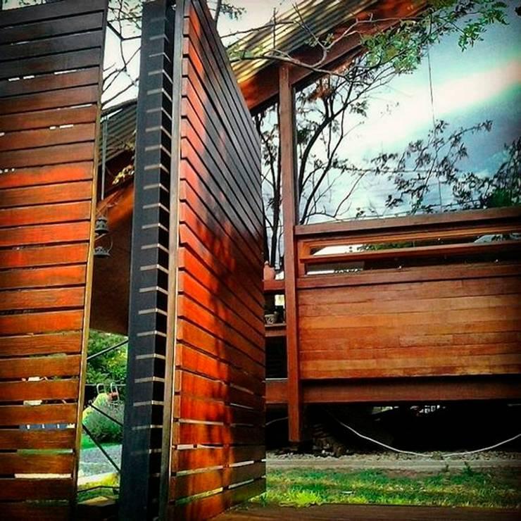 Terrazas de estilo  por juan olea arquitecto
