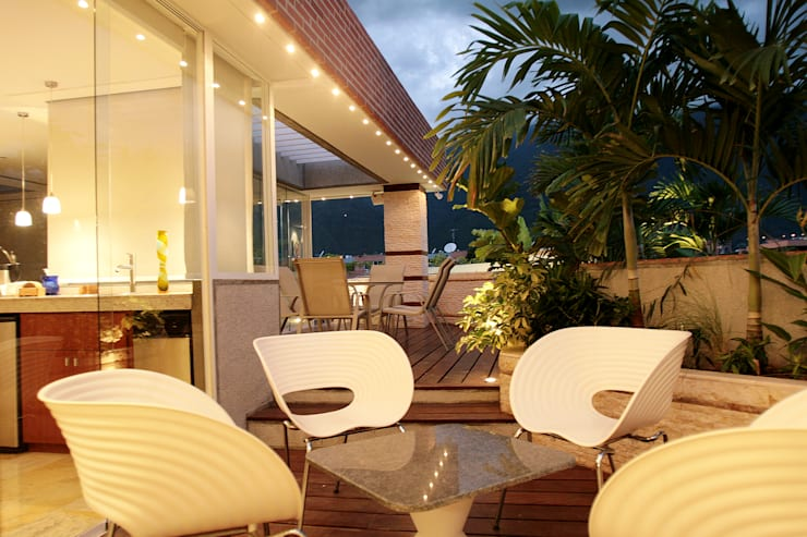 Pent House 505: Jardines de estilo  por Arq Renny Molina