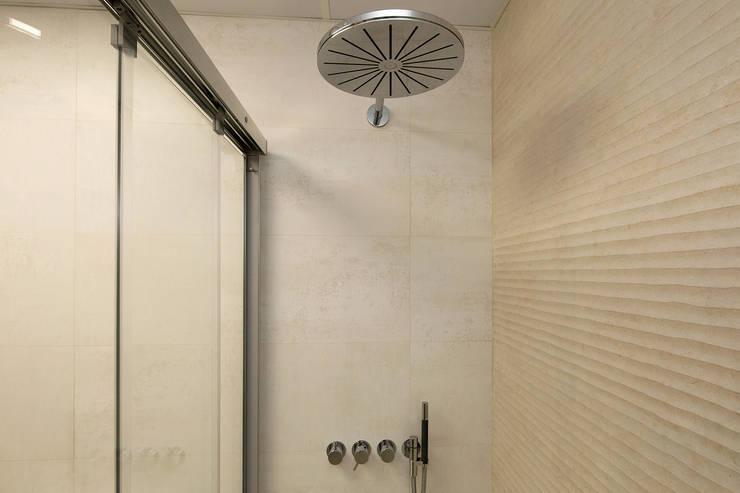 Baños de estilo  por Ardes Arquitectos