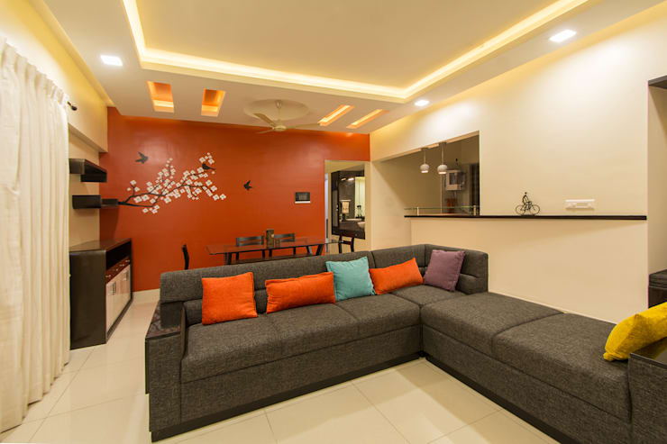 A residence for Mr.Nitin Warrier at Blue Ridge ,Hinjewadi ,Pune:  Living room by Navmiti Designs