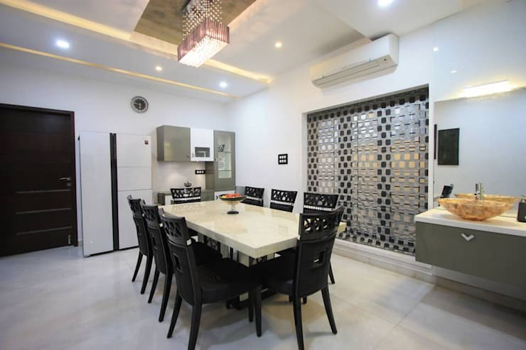 Dining:  Dining room by Ansari Architects,Modern