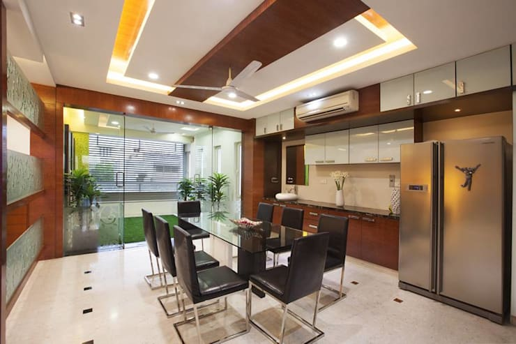 Dining room:  Dining room by Ansari Architects