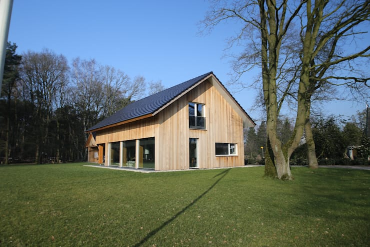 Houses by STUDIO = architectuur, Modern Wood Wood effect