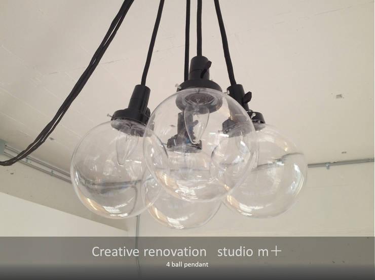4ballpendant: studio m+ by masato fujiiが手掛けたダイニングルームです。