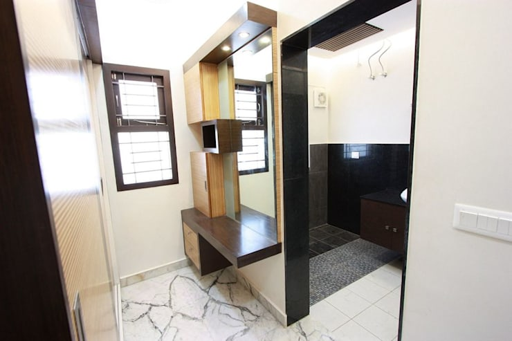 Dressing room:  Dressing room by Ansari Architects