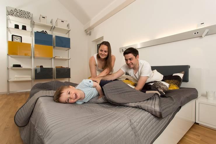 Bedroom by K-MÄLEON Haus GmbH