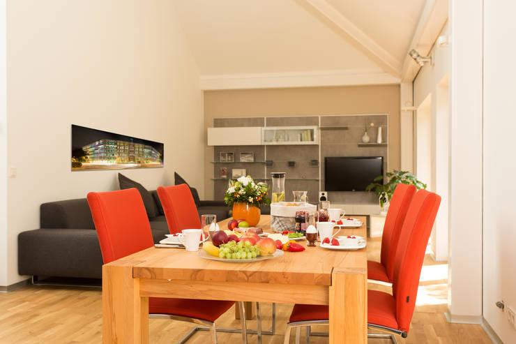 Dining room by K-MÄLEON Haus GmbH