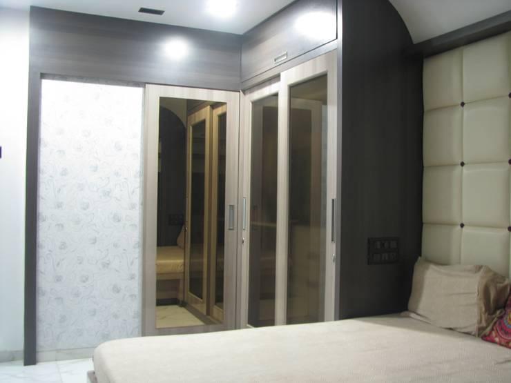 Byculla:  Bedroom by TRINITY DESIGN STUDIO,Modern