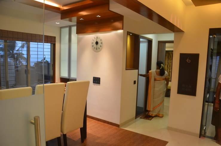 Mahalakshmi:  Dining room by TRINITY DESIGN STUDIO,Modern