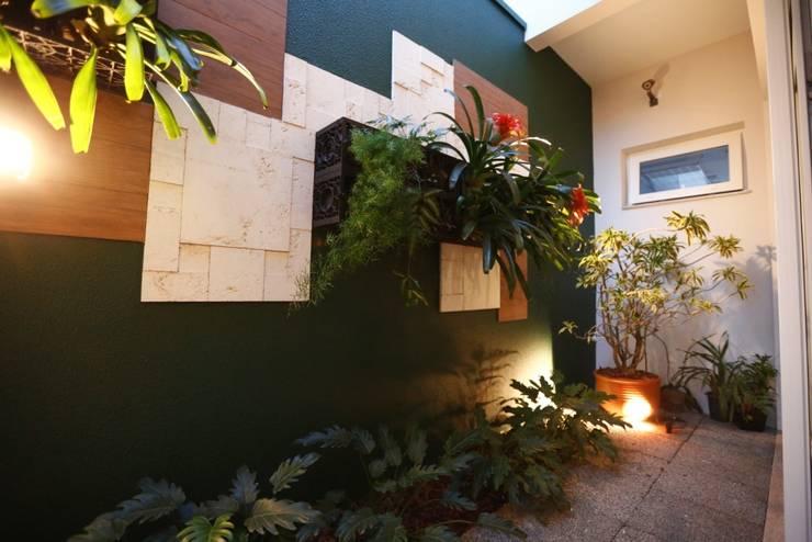 Jardin de style  par Arquitetura Ao Cubo LTDA