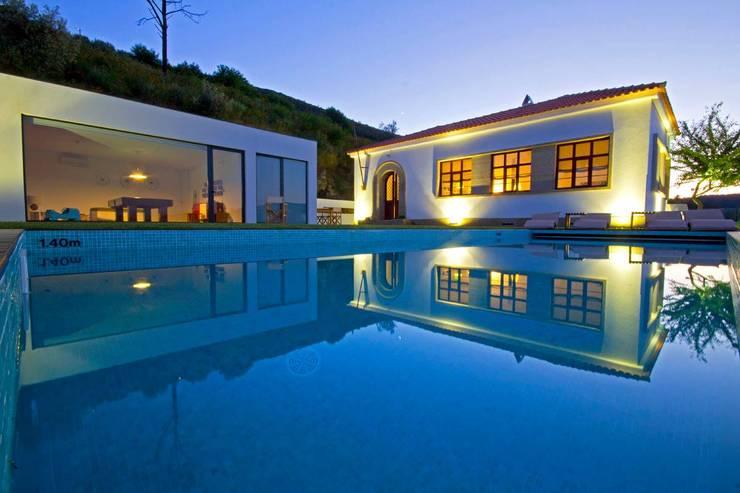 DEPOIS: Casas  por MHPROJECT,Moderno