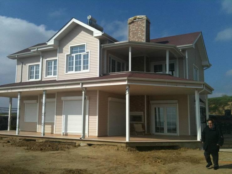 Projekty,  Domy zaprojektowane przez Murat  Kaya Mimarlik Ltd. Sti.