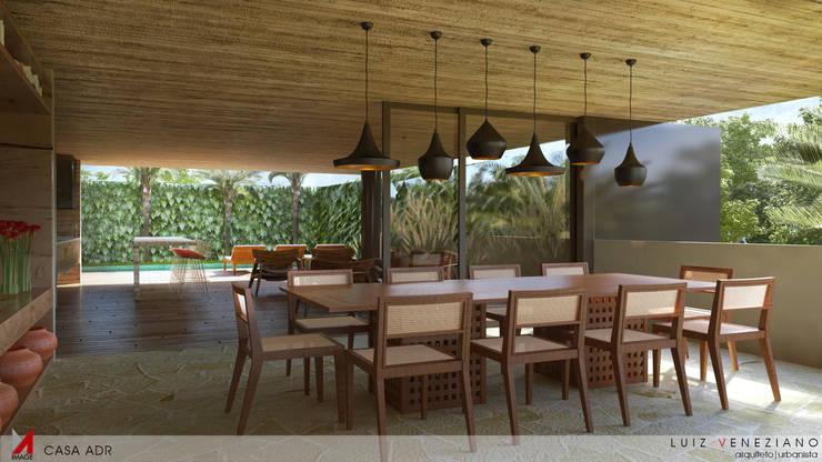 Dining room by STUDIO LUIZ VENEZIANO