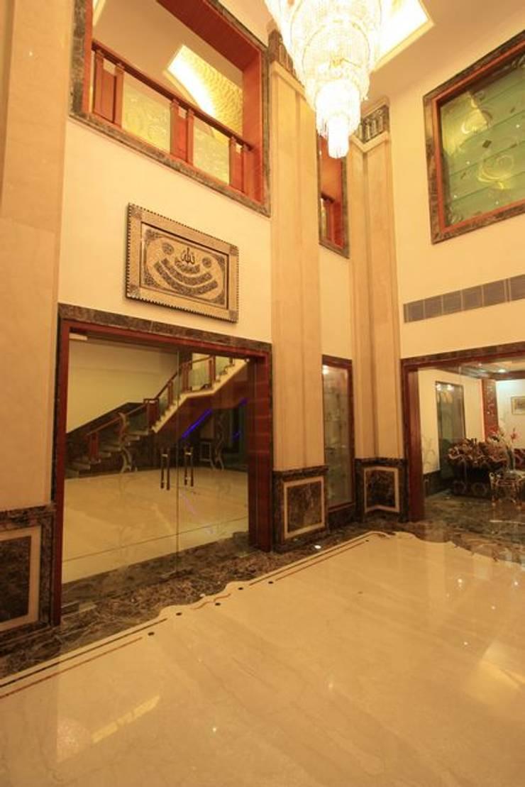 Lobby:  Living room by Ansari Architects