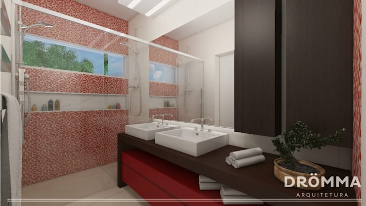 INTERIORES M  G 147: Banheiros  por Drömma Arquitetura