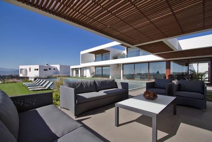 Casas de estilo  por G4 Arquitectos Asociados