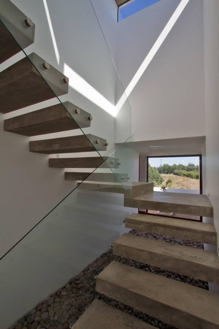 Casa Ortiz: Casas de estilo  por G4 Arquitectos Asociados