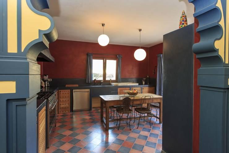 New Customer photos of cement tiles: Cocinas de estilo mediterráneo de Crafted Tiles