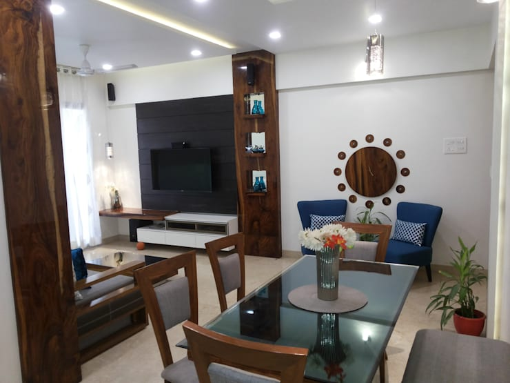DB WOODS , GOREGAON:  Dining room by J SQUARE - Architectural Studio