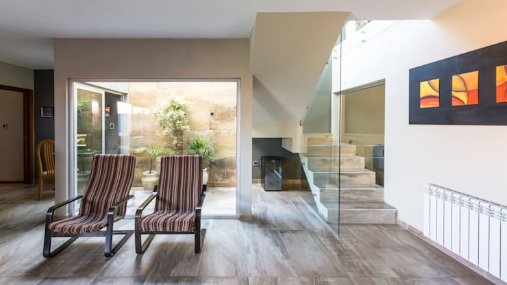 Conservatory by KARLEN + CLEMENTE ARQUITECTOS