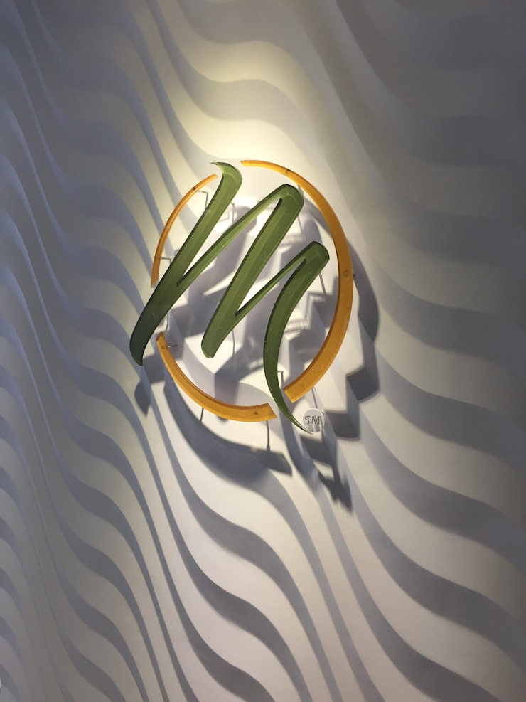Oficinas Mannatech Bogotá: Oficinas y Tiendas de estilo  por Integra Proyectos