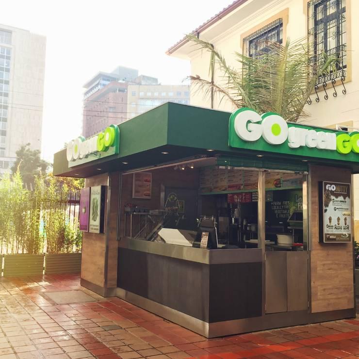 Quiosco Go Green - Universidad del Rosario: Espacios comerciales de estilo  por Integra Proyectos