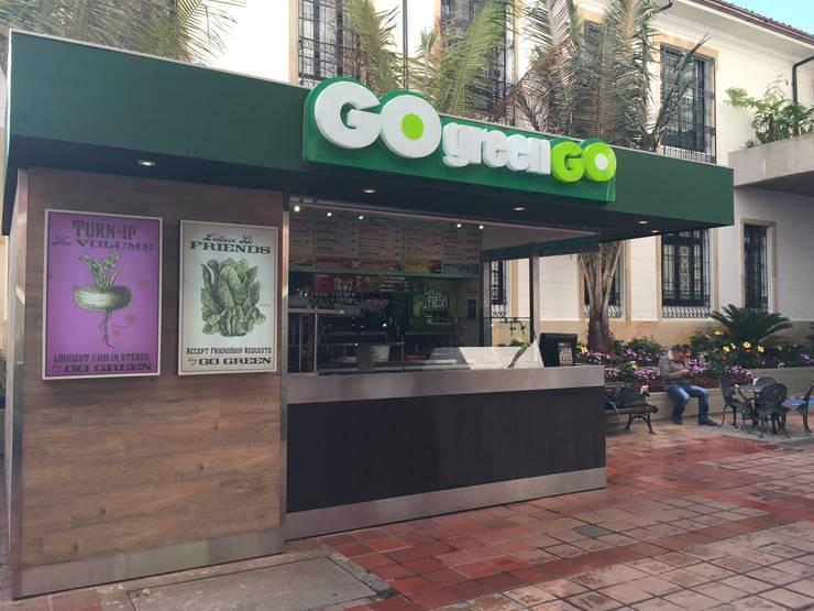 Quiosco Go Green – Universidad del Rosario: Espacios comerciales de estilo  por Integra Proyectos