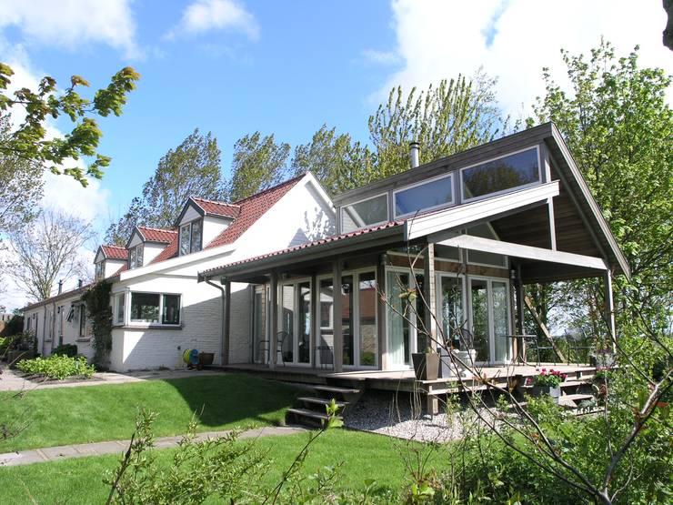 Casas de estilo rural por Dick de Jong Interieurarchitekt