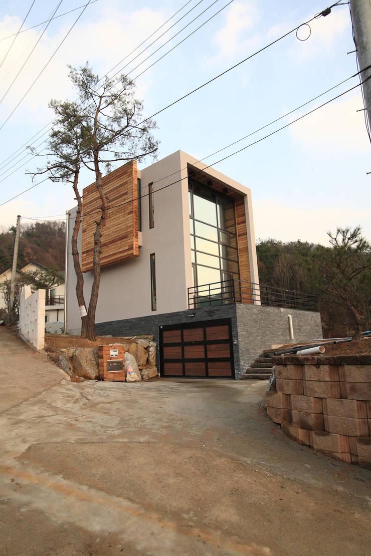 M 하우스 전경: SG international의  주택,모던 콘크리트