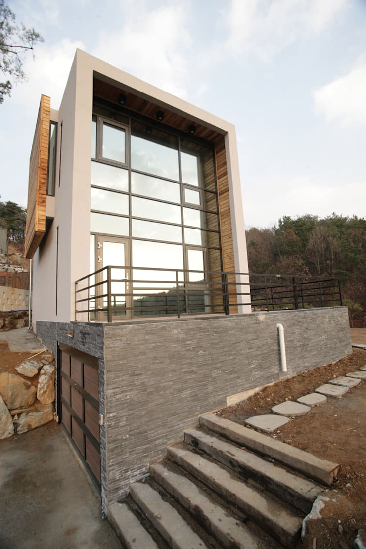 Casas de estilo  de SG international, Moderno Piedra