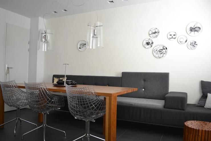 INTERIEURONTWERP ZITKAMER, EETKAMER EN HAL:  Eetkamer door Binnenkijken Interieuradvies, Modern
