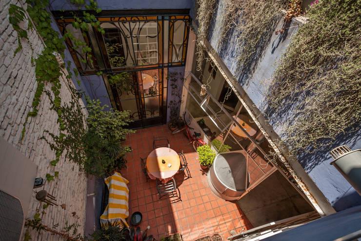 Galpón Lola: Casas de estilo  por Pop Arq
