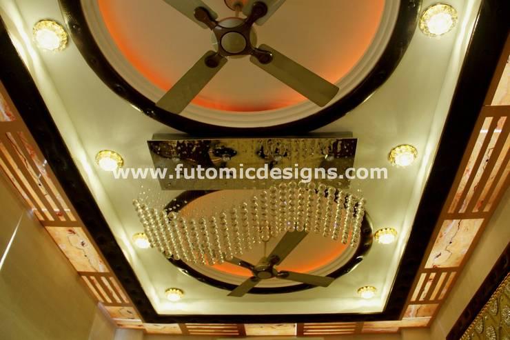 Premium Home Interiors:  Living room by Futomic Design Services Pvt. Ltd.,Modern Glass