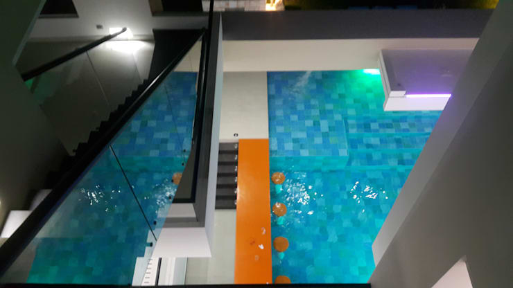 Bar piscina.: Piscinas de estilo  por Camilo Pulido Arquitectos