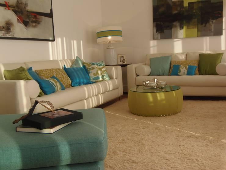 Decoração Caldas: Salas de estar  por Obrasdecor