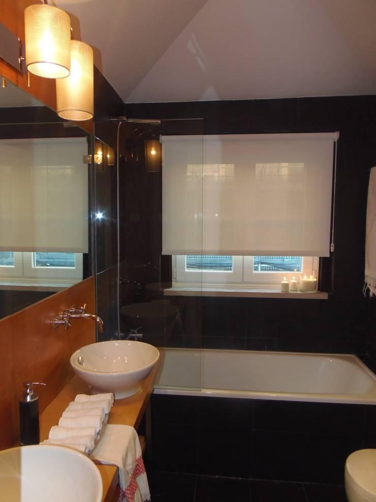Decoração Caldas: Casas de banho  por Obrasdecor