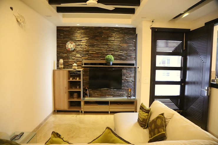 lobby lcd unit:  Living room by Aayam Consultants