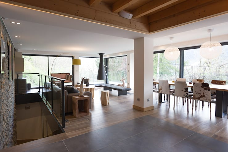 Soleya: Salon de style  par Chevallier Architectes