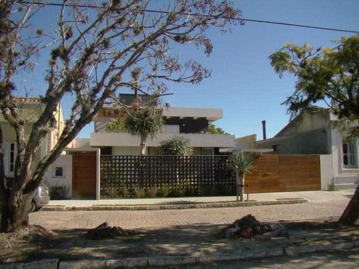 Casas de estilo  por Jader e Ivan Arquitetos