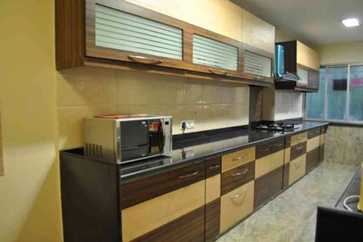 Vikas singh apartment :  Kitchen by Arturo Interiors