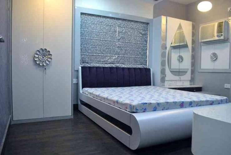 Shah residence :  Bedroom by Arturo Interiors