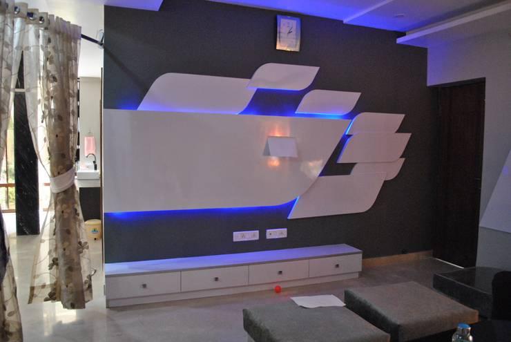 Nawab alam:  Living room by Arturo Interiors