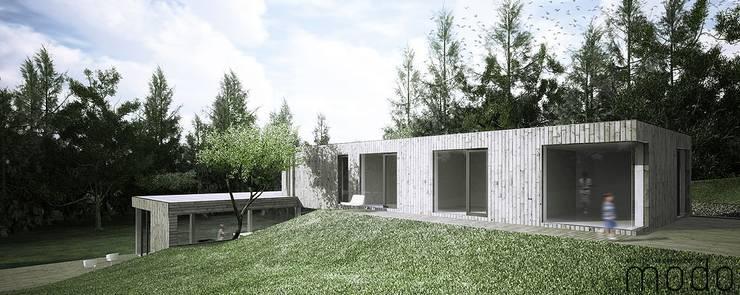 Moradia em São Miguel do Rio Torto: Casas  por Modo Arquitectos Associados